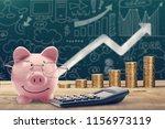 piggy bank  calculator and... | Shutterstock . vector #1156973119