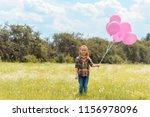 adorable child with pink... | Shutterstock . vector #1156978096