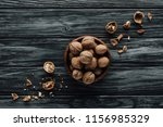 walnuts in wooden bowl with... | Shutterstock . vector #1156985329