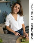 woman preparing salad in the... | Shutterstock . vector #1157013943