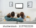 family watching tv in room at... | Shutterstock . vector #1157022220