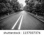 asphalt road outside the city.... | Shutterstock . vector #1157037376