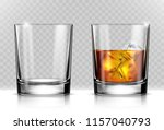 Glass of scotch whiskey and ice on transparent background