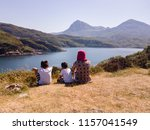 family facing river and mountain | Shutterstock . vector #1157041549