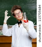 Small photo of Mad professor in glasses admires his experimental red liquid