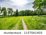 following the footpath through... | Shutterstock . vector #1157061403