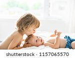 baby in bed with his brother... | Shutterstock . vector #1157065570