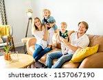 family having fun on sofa. | Shutterstock . vector #1157067190