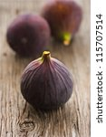 Fresh ripe figs on an old wooden board. - stock photo