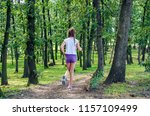 child girl back jogging in... | Shutterstock . vector #1157109499