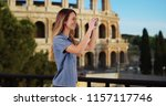 smiling woman tourist taking... | Shutterstock . vector #1157117746