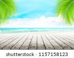 empty wooden table and palm... | Shutterstock . vector #1157158123