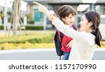 mother and four kids holding... | Shutterstock . vector #1157170990