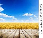 wood floor over yellow wheat... | Shutterstock . vector #115722799
