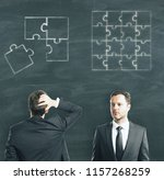 businessmen on chalboard... | Shutterstock . vector #1157268259