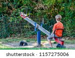 boy alone playing at the see... | Shutterstock . vector #1157275006