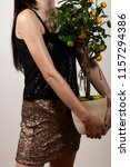 girl holding an orange tree | Shutterstock . vector #1157294386