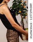 girl holding an orange tree | Shutterstock . vector #1157294389