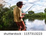 fishing on the shore of the... | Shutterstock . vector #1157313223
