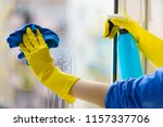 female hand in yellow gloves... | Shutterstock . vector #1157337706