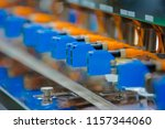 Small photo of Photoelectric Sensor installed in a row of industrial machine in a factory