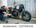 biker checking custom... | Shutterstock . vector #1157349133