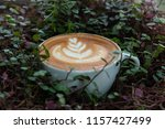 a cup of hot latte coffee cup | Shutterstock . vector #1157427499