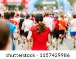 running crowd at the marathon.... | Shutterstock . vector #1157429986