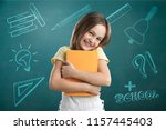 school icon and child on a... | Shutterstock . vector #1157445403