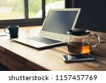 laptop on wooden desk with... | Shutterstock . vector #1157457769