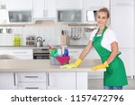 woman cleaning table with rag... | Shutterstock . vector #1157472796