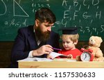 kid studies individually with...   Shutterstock . vector #1157530633