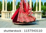 indian bridal showing wedding... | Shutterstock . vector #1157543110