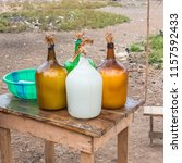 palm wine in bottles sold in a... | Shutterstock . vector #1157592433