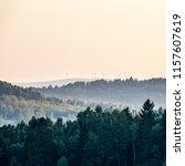 wind turbines up on mountain.... | Shutterstock . vector #1157607619