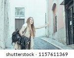 cheerful female tourist... | Shutterstock . vector #1157611369