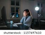 overwhelmed businesswoman... | Shutterstock . vector #1157697610