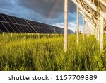 solar panels on a green field.... | Shutterstock . vector #1157709889