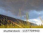 solar panels on a green field.... | Shutterstock . vector #1157709943
