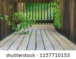 walking along summer s wooden...   Shutterstock . vector #1157710153