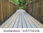 walking along summer s wooden...   Shutterstock . vector #1157710156