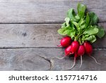 radish bunch on rustic wooden... | Shutterstock . vector #1157714716