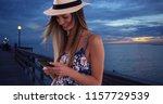 happy woman in floral romper... | Shutterstock . vector #1157729539