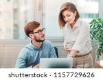 young intern receives feedback... | Shutterstock . vector #1157729626