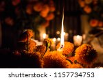 Stock photo candle among flowers day of the dead janitzio cemetery 1157734753