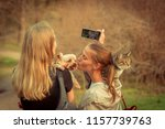 Stock photo selfy a girl with a cat on her shoulder takes a girl and a dog 1157739763