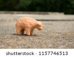 A Clay Pottery Sheep Stands On...