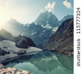 Stock photo scenery of high mountain with lake and high peak 115777324