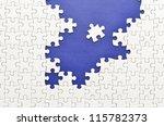 Stock photo plain white jigsaw puzzle mount in dark blue 115782373