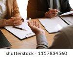 examiner reading a resume...   Shutterstock . vector #1157834560